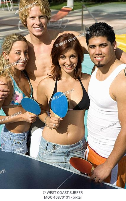 Group Portrait of Young People Including Teenage Girl 18-19 Playing Ping-Pong
