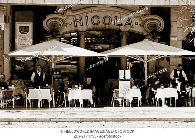 Alfresco cafe culture at Nicola a well known Art Deco style cafe on Rossio square (Praca Dom Pedro 1V) Lisbon Portugal western Europe