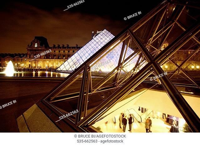 The night view of Cour Napoleon of Musee du Louvre with Pyramid Entrance in the background. Paris. France