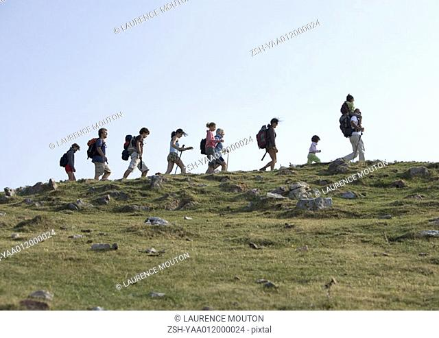 Hikers walking in line