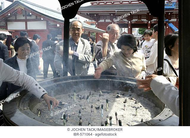 Japan, Tokyo: Shrine festival, called Matsuri. Asakusa Kannon Shrine Temple district. incense fountain