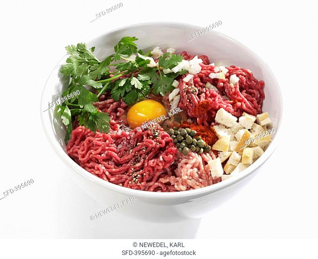 Ingredients for burgers made with minced beef and pork