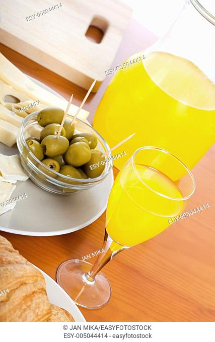 Detail of kitchen table with fresh olives and juice
