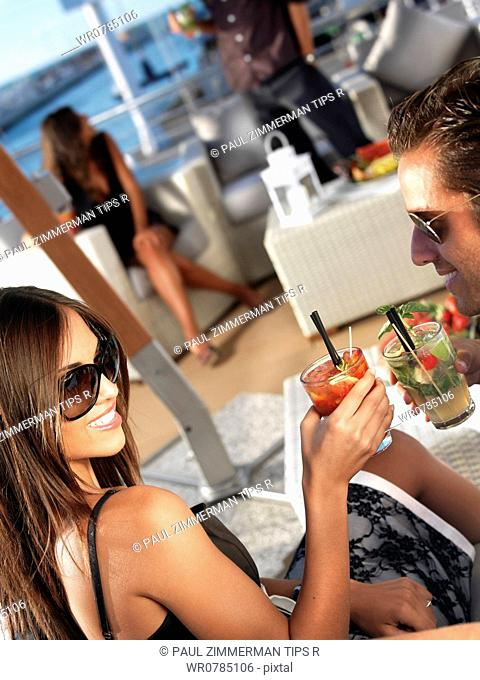 Couple having aperitif at outdoors cafe
