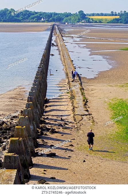 UK, Scotland, Lothian, Edinburgh Area, Cramond, Causeway and Pylons leading to the Cramond Island at low tide.