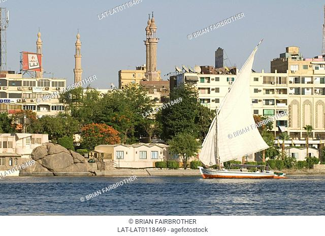 Aswan stands on the east bank of the Nile at the first cataract and is a busy market and tourist centre. Traditional boats,feluccas with single sails