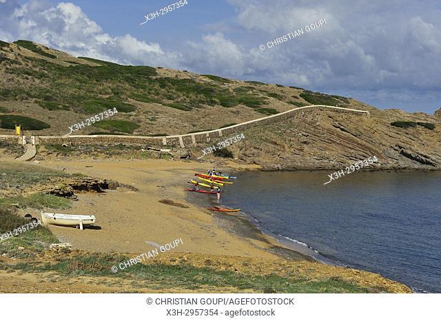kayaks at Cala Mica inlet near Cape Cavalleria on the North Coast of Menorca, Balearic Islands, Spain, Europe