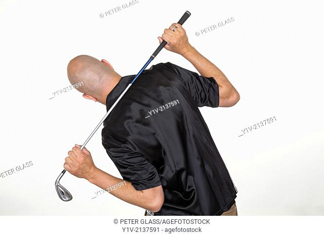 Middle-age bald man holding a golf club
