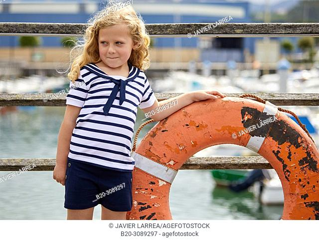 Girl in sailor clothes, Marina Urola, Santiago beach, Zumaia, Gipuzkoa, Basque Country, Spain, Europe