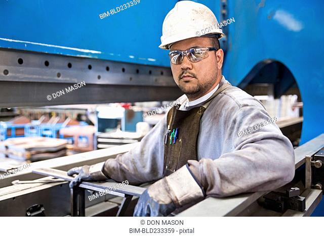 Pacific Islander worker posing in factory
