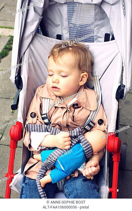 Toddler sleeping in stroller