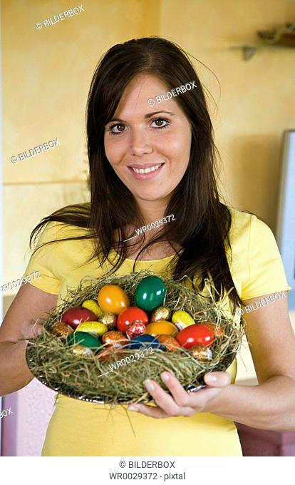 woman with easter nest