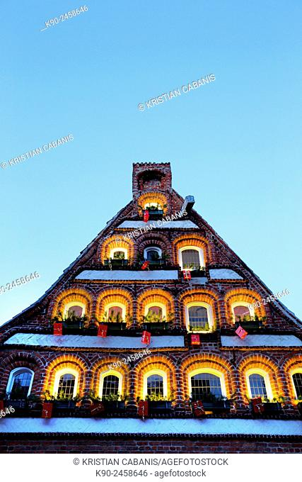 Facade of old houses with Christmas decoration with wrapped packages in the windows in the old part of Lueneburg, Lower Saxonya, Germany, Europe
