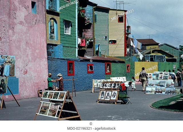 A street of the barrio La Boca in Buenos Aires, the old italian neighborhood of the Argentina's capital, with its walls and dwellings painted in variuos and...