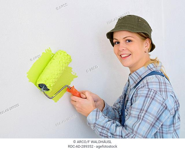 painter woman with a paint roller
