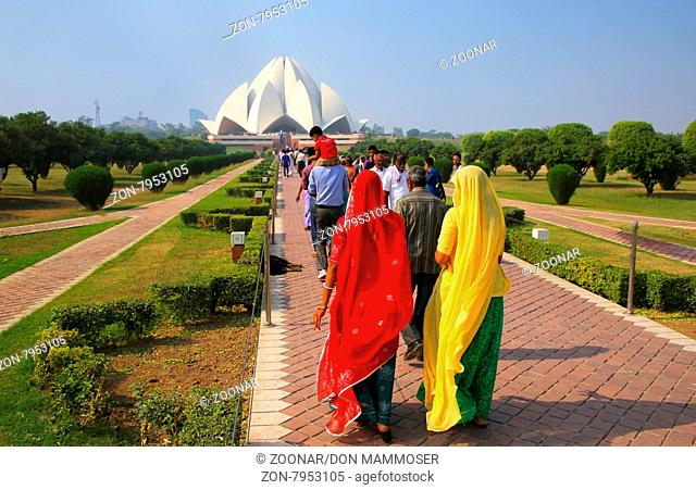 People walking to Lotus temple in New Delhi, India