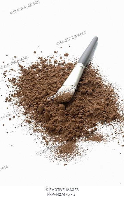 Chocolate powder and a brush