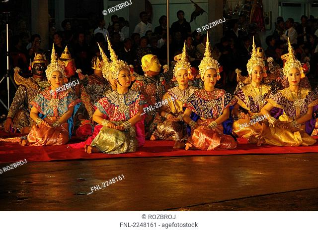 Traditional dancers performing dance based on Hindu epic Ramayana, Wat Trimitr, Bangkok, Thailand