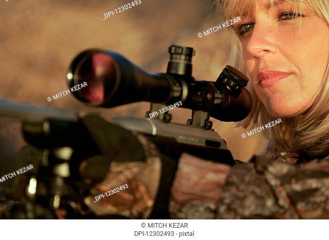 Female Varmint Hunter with Rifle