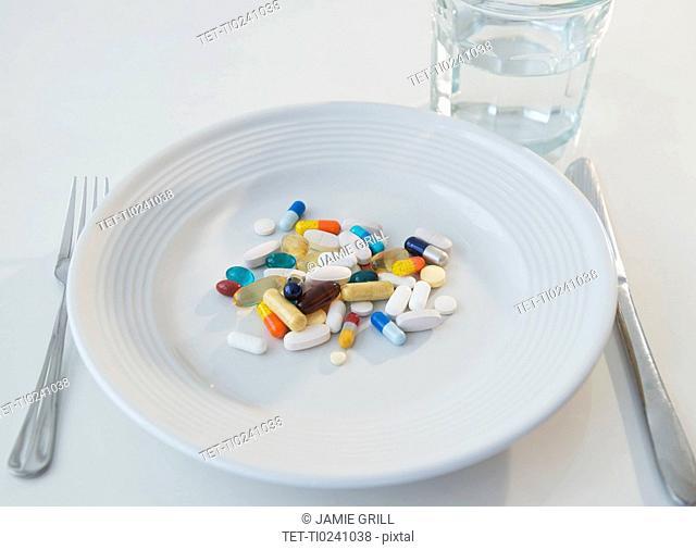 Studio shot of pills on plate