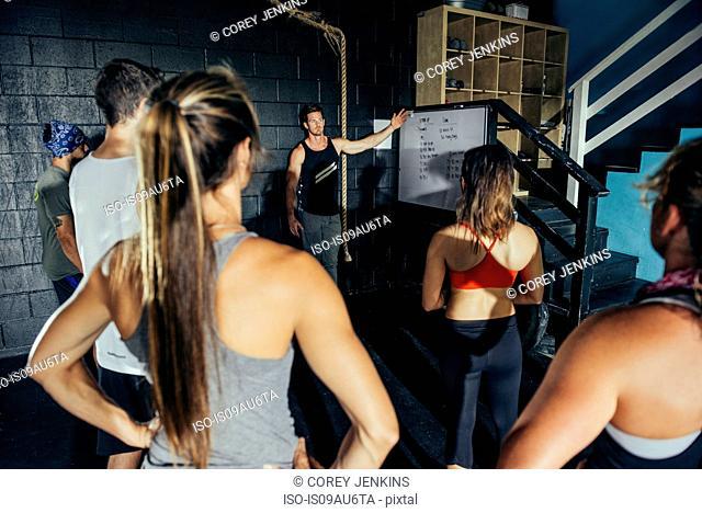 Team at meeting in gym