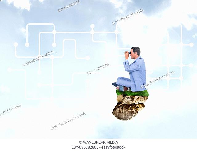 Businessman with binoculars on floating rock platform with interface in sky