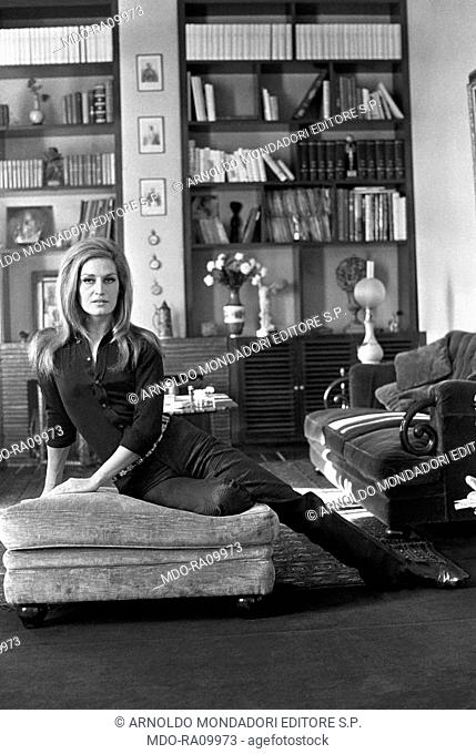 Italian-born French actress and singer Dalida (Iolanda Cristina Gigliotti) posing in the living room of her house. Paris, 1970