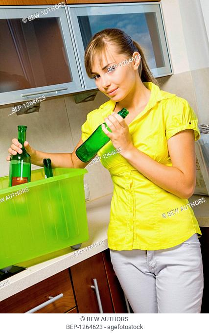 Woman cleaning in her kitchen