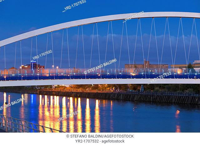 Light reflections on the canal of Salford quays with the Lowry bridge, Salford Quays, Manchester, England