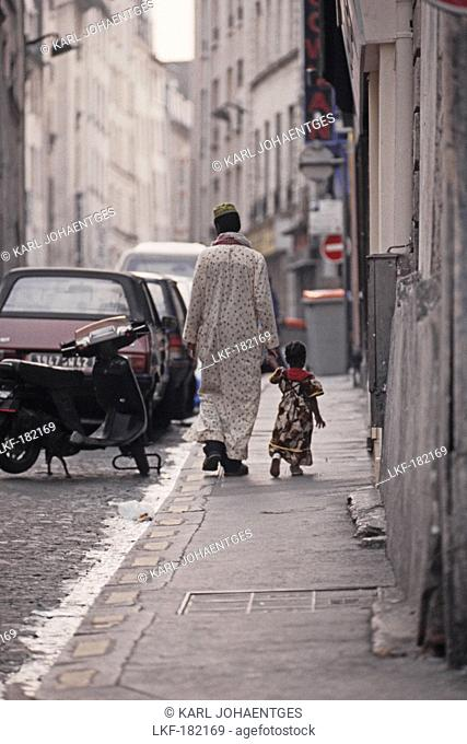 Immigrant father with child in the African Quarter, Barbes in the 18, 19e Arrondissement, Paris, France