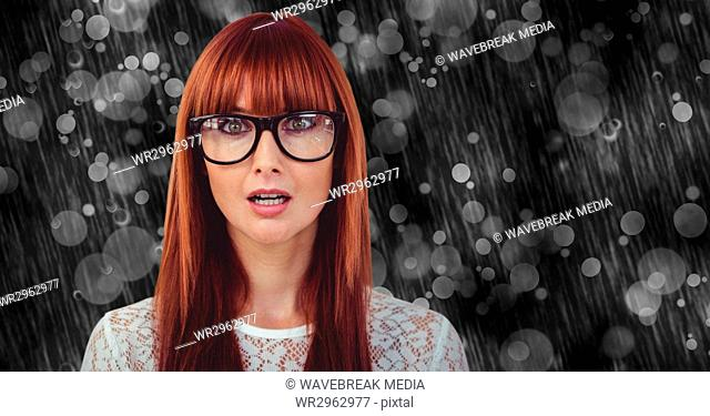 Surprised woman wearing eyeglasses on rainy day