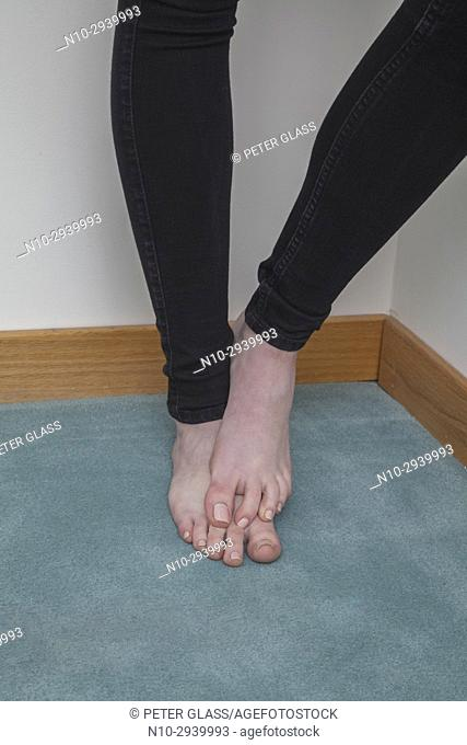 Teenage girl's legs and bare feet