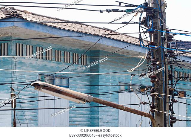 A mess of electric wire on the electricity pole