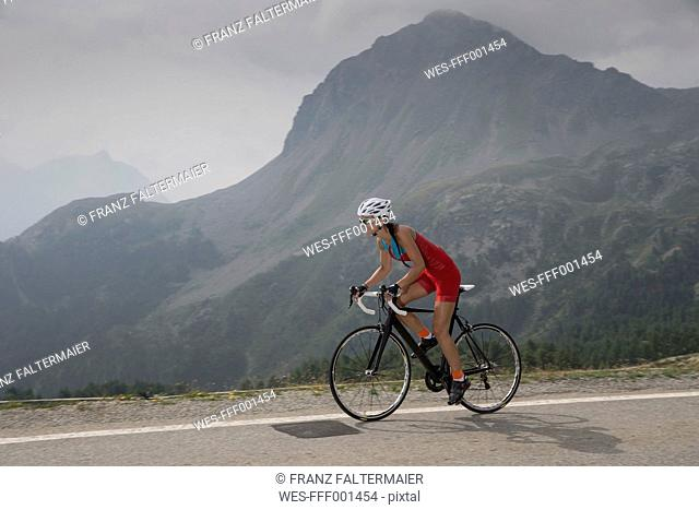 Switzerland, Engadin, cyclist on Bernina Pass