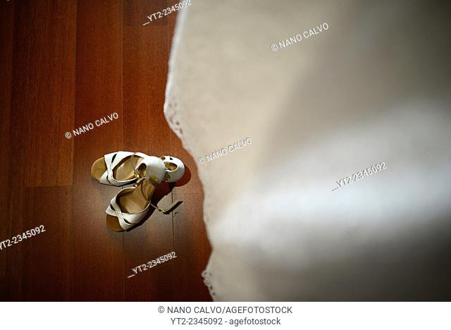 Wedding dress and shoes in room