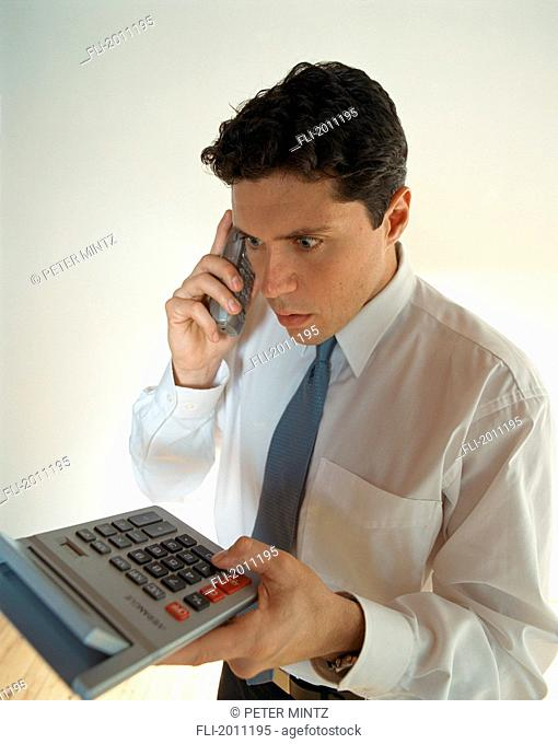 Fv3192, Peter Mintz; Business Man Holds Calculator, Surprised Expression