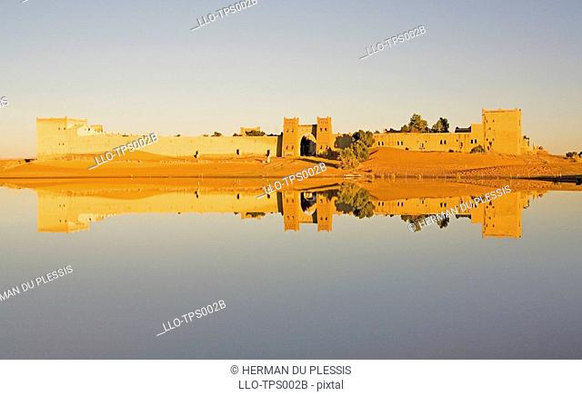 Reflection of Moroccan City Walls in a Dam  Merzouga, Erg Chebbi, Sahara Desert, Morocco, North Africa