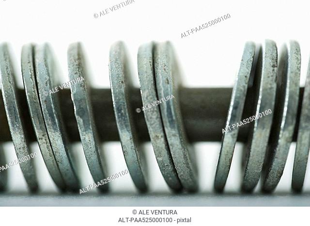 Metal washers on screw, extreme close-up