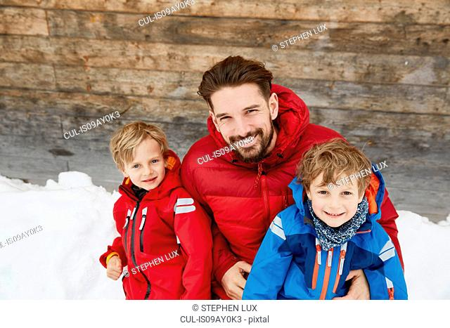 Portrait of man and sons at cabin in snow, Elmau, Bavaria, Germany