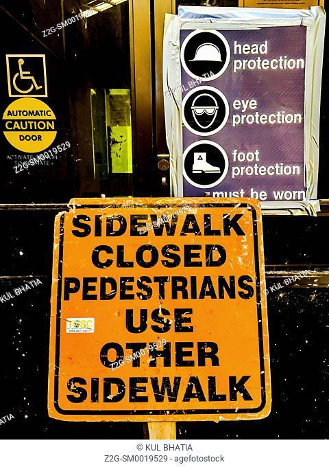 Sign, sidewalk closed, at work site, Ontario, Canada