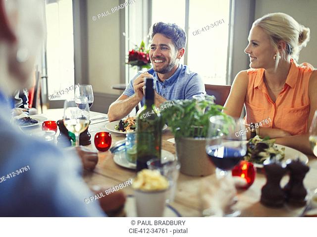Smiling couple dining at restaurant table
