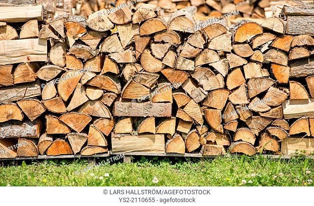 Big stack of firewood logs outdoors