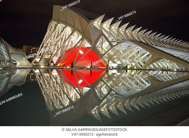 Night photography of the Prince Felipe Museum of Valencia, illuminated a red façade in honor of the festivities of the Fallas. Valencia, Spain