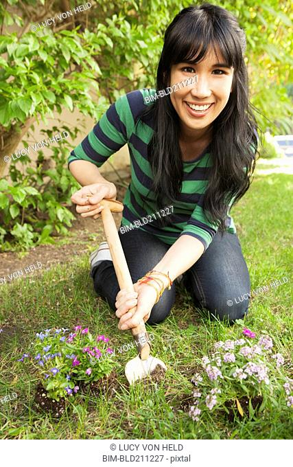 Woman planting flowers outdoors