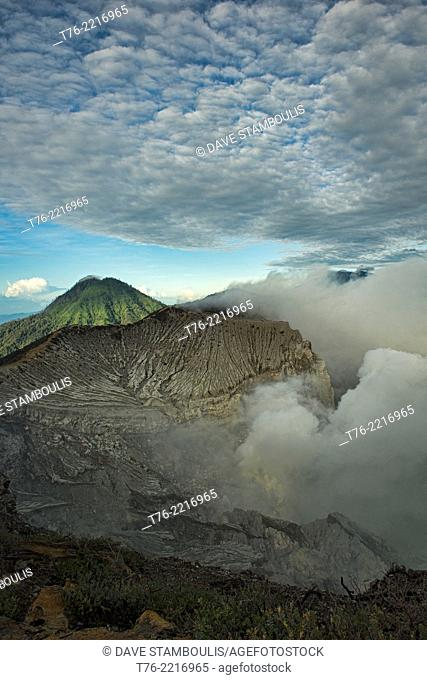 view of the smoking Kawah Ijen volcanic crater and lake, Java, Indonesia