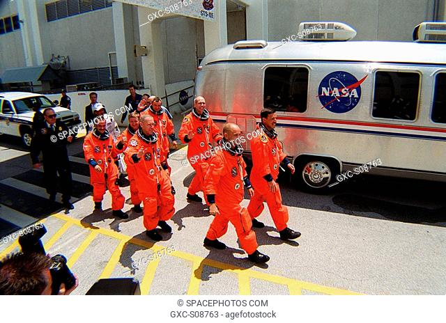 08/09/2001 -- The STS-105 crew eagerly leads the way to the Astrovan, followed by the Expedition Three E3 crew, and the drive to Launch Pad 39A for launch