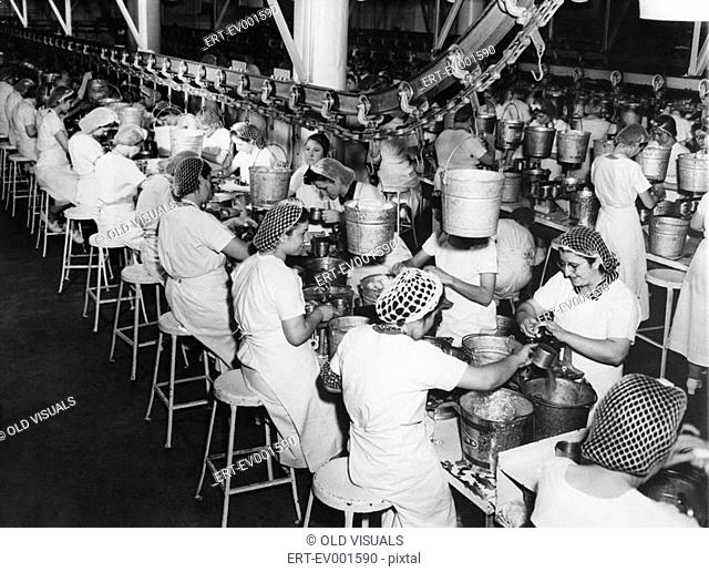 FACTORY WORKERS All persons depicted are not longer living and no estate exists Supplier warranties that there will be no model release issues