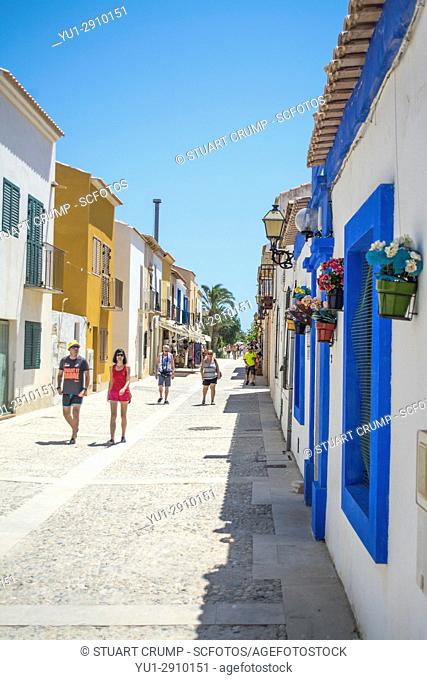Tourists walking down the narrow main street on the island of Tabarca Spain