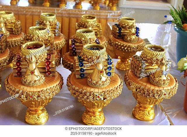 Golden offering pots inside the Buddhist temple at Ban Nong Chaeng, Phetchabun, Thailand