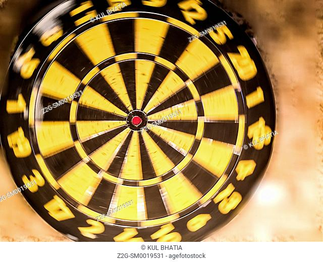 A gently spinning dart board, symbolizing slow movement, Ontario, Canada